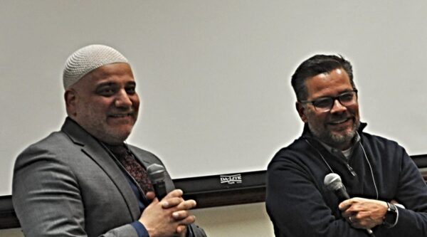 Imam Imad Enchassi and Mitch Randall laughing together