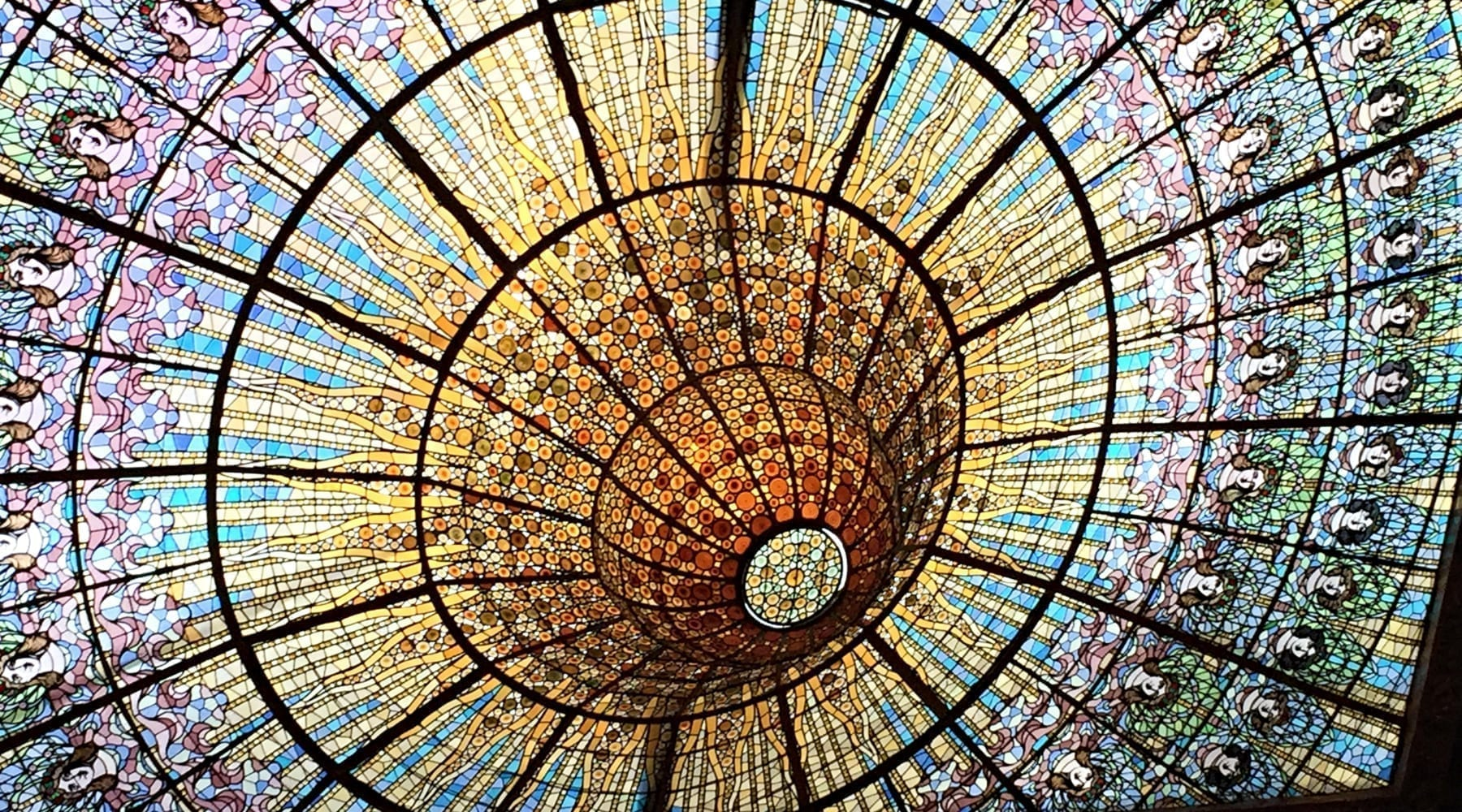 """The ceiling of a music hall in Barcelona. """"It shows so many women, side by side, all gathered around the light,"""" Christa Brown said. """"To me, it seems meaningful because it makes me think of my """"sisters-in-arms."""" (Photo: Christa Brown)"""