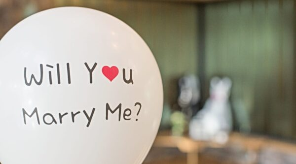 White balloon with marriage proposal