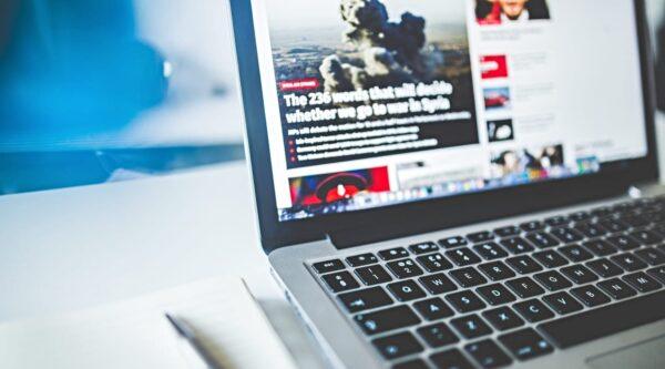 Laptop displaying news website