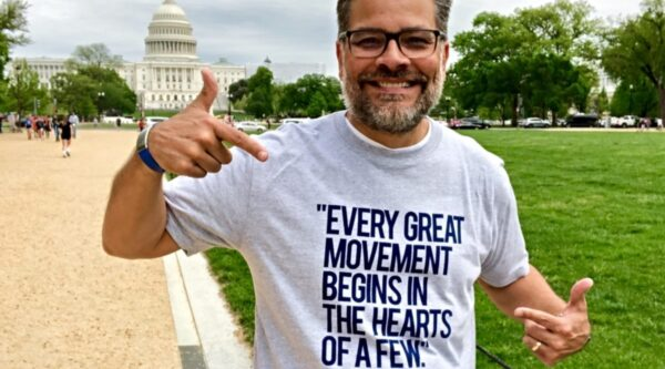 Mitch Randall wearing T-shirt with Rauschenbusch quote in Washington, D.C.