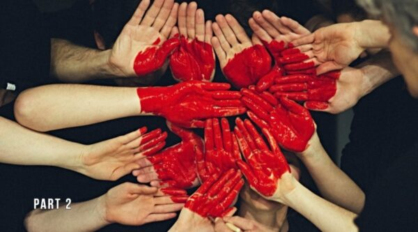 A group of hands with red heart painted on them