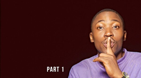 African American male holding finger to his lips