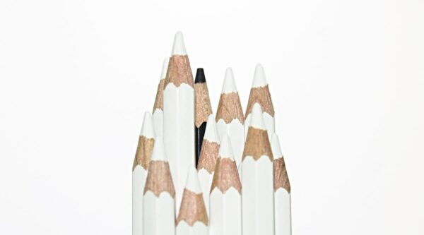 White pencils with one black pencil