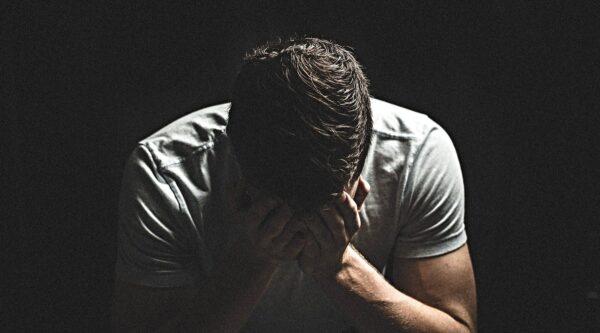 Despairing man with hands in head