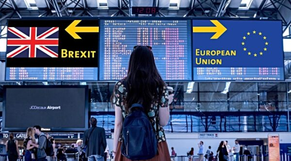 Young woman looking up at Brexit and EU signs