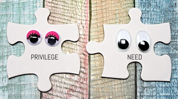 Two jigsaw puzzle pieces with googly eyes