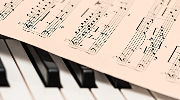 Sheet music resting on piano keys