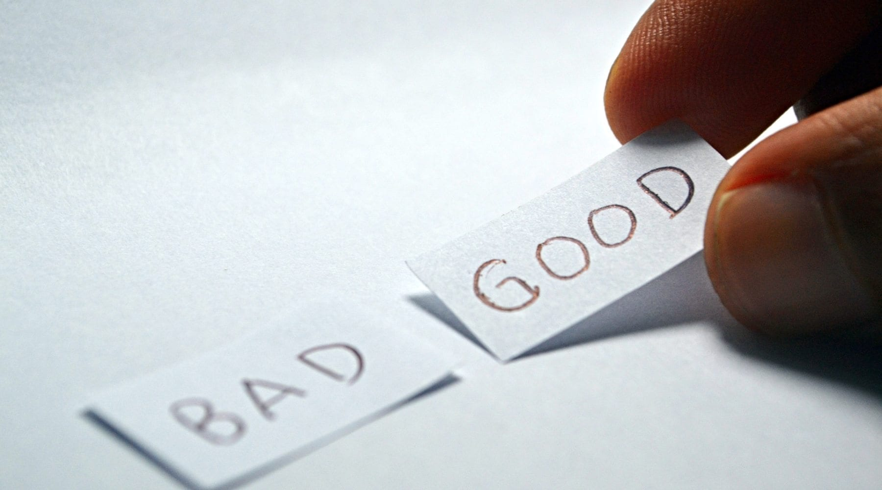 Two slips of paper with 'bad' and 'good' written on them