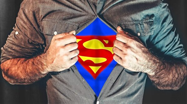 Man ripping shirt to reveal Superman costume