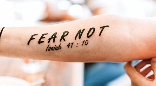 Arm with 'fear not' tattoo