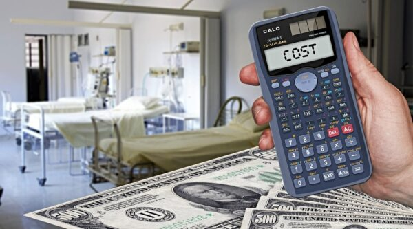 Calculator with word 'cost' in hospital room, $500 bills