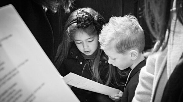 Boy and girl singing in church service