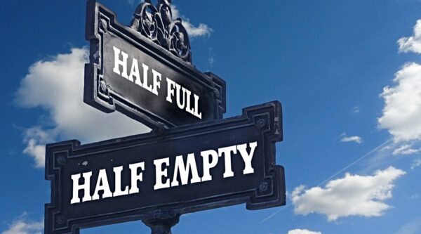 Perpendicular signs reading 'half full' and 'half empty'