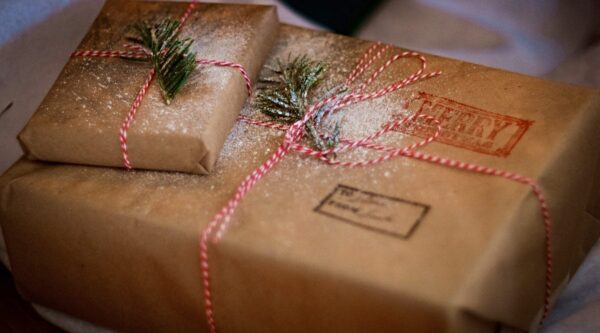 Brown paper-wrapped gift with Christmas decorations