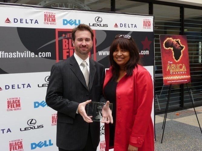 Cliff Vaughn receiving an award
