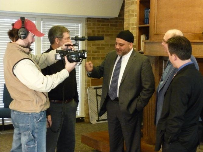 "Left to Right: Cliff Vaughn, T Thomas, Imad Enchassi, Bruce Prescott and Orhan Osman. Shooting ""Different Books, Common Word"" in Norman Oklahoma in 2009. Photo by Robert Parham"
