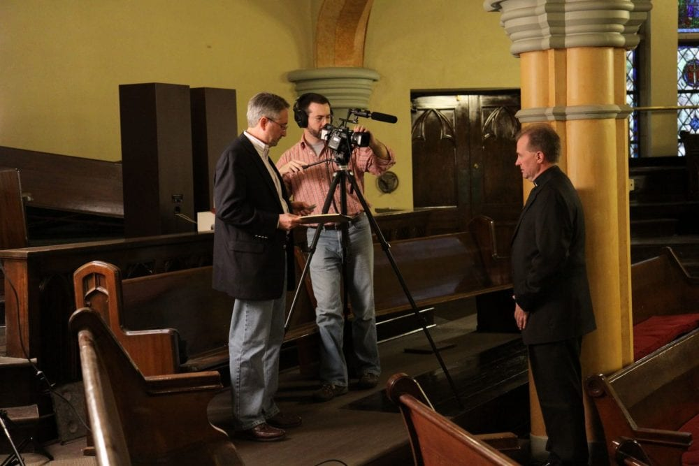 Robert Parham (left) and Cliff Vaughn (center) of EthicsDaily filming.