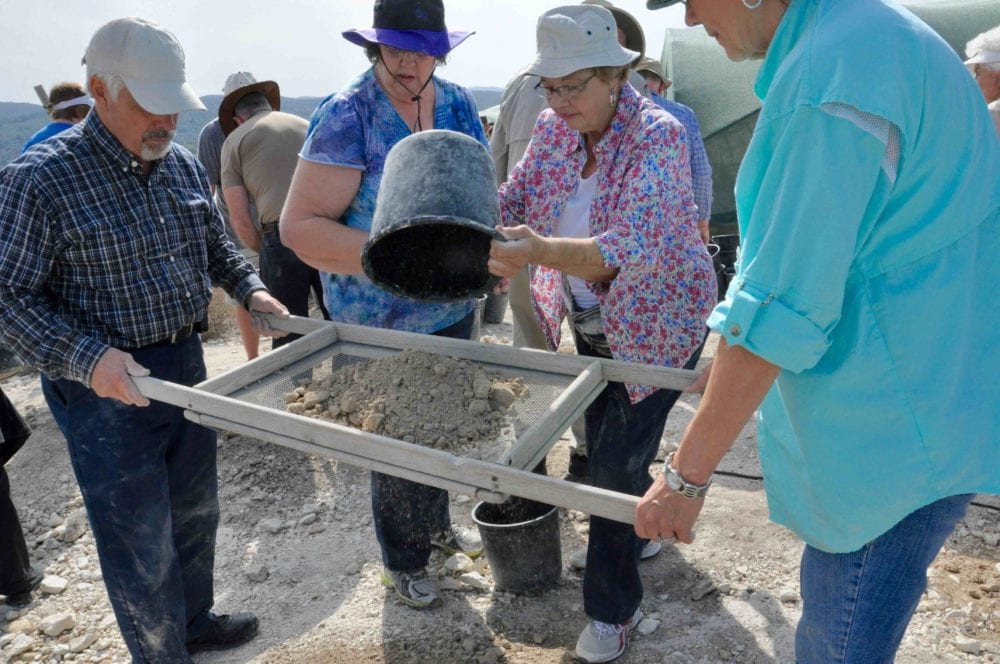 Archaealogical dig during a Nurturing Faith guided experiential trip.