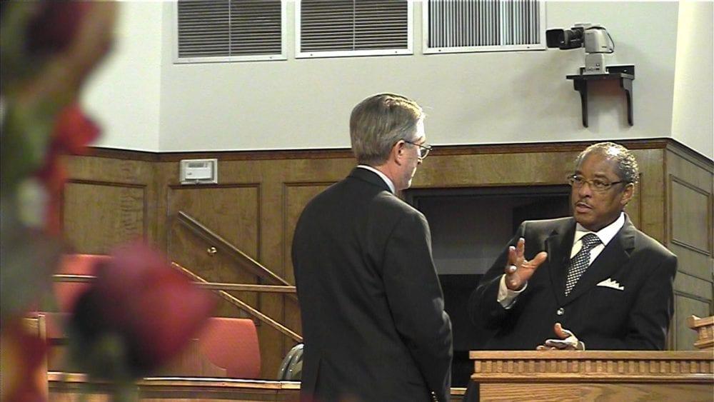 Robert Parham (left) interviews Julius Scruggs at First Missionary Baptist Church in Huntsville, Ala. Video still from EthicsDaily.com