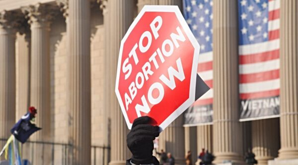 Protest sign shaped like stop sign and opposing abortion
