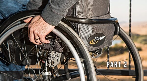 Wheelchair with man's hand on wheel