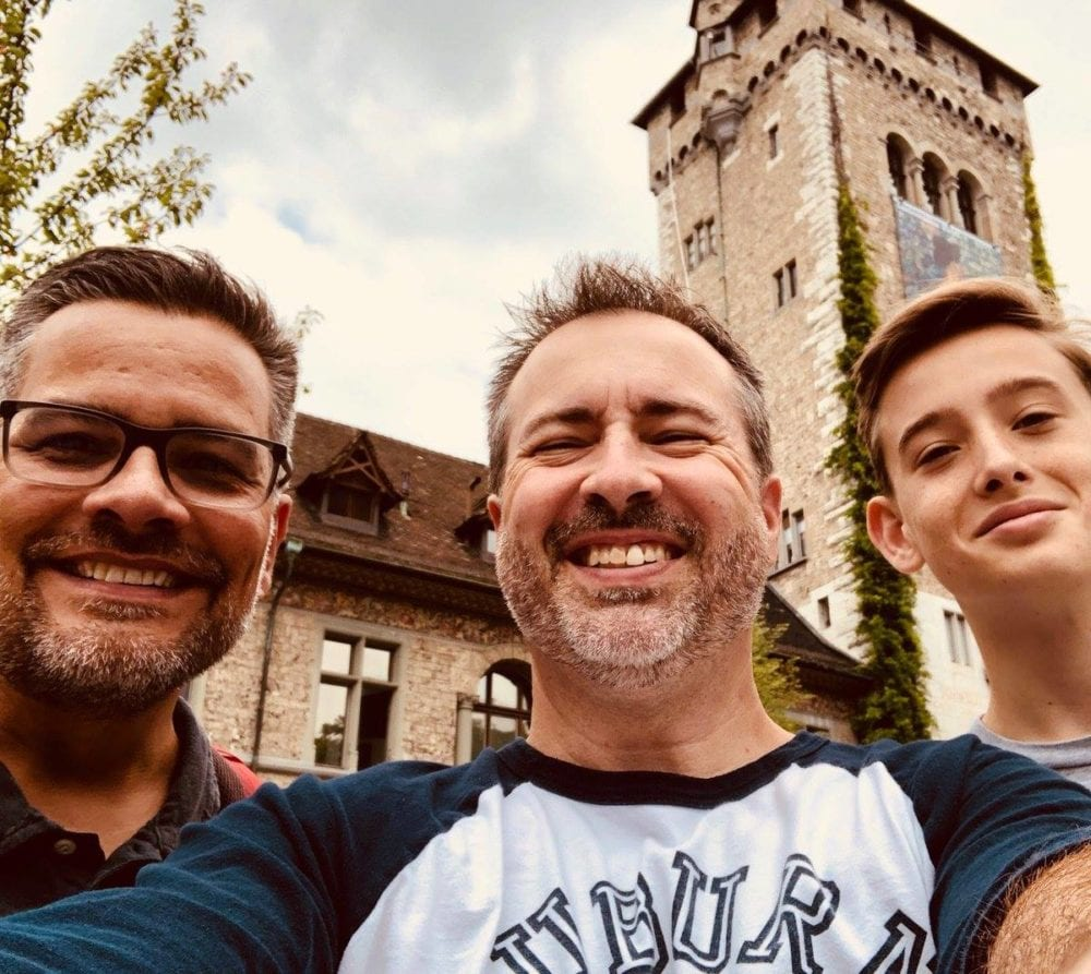 Mitch Randall (left) and Cliff Vaughn (center) of EthicsDaily with Vaughn's son Jack in Zurich.