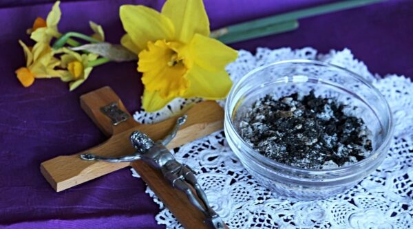 Bowl of ashes, flower and cross