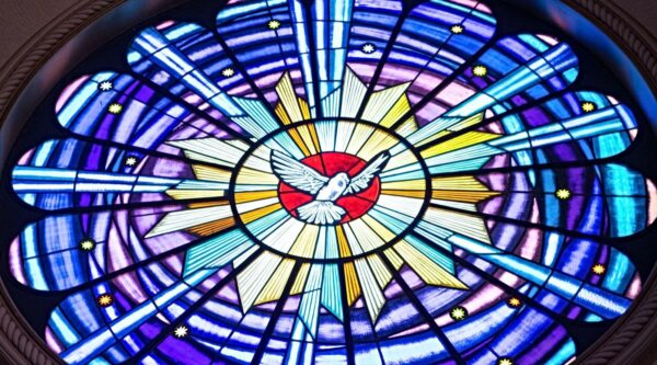 Stained-glass window with dove in center