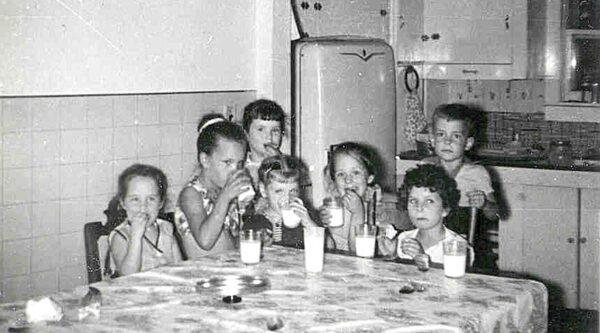 Seven children around kitchen table