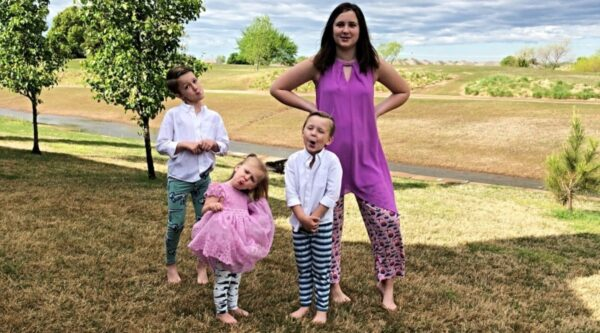 Four children posing in field