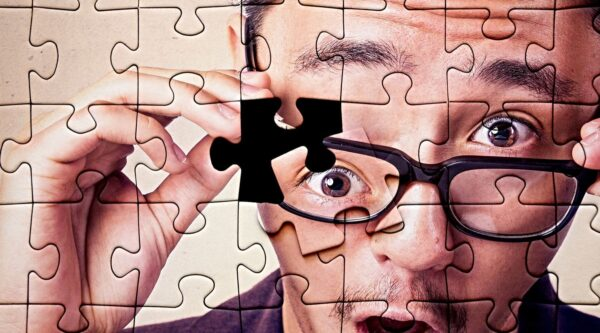 Nearly complete puzzle of surprised man's face