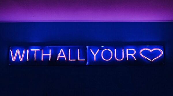 Neon sign reading With All Your Heart