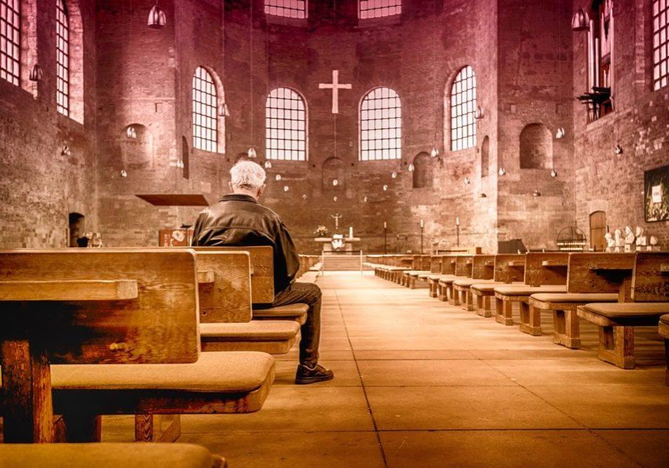 a man sitting in a church